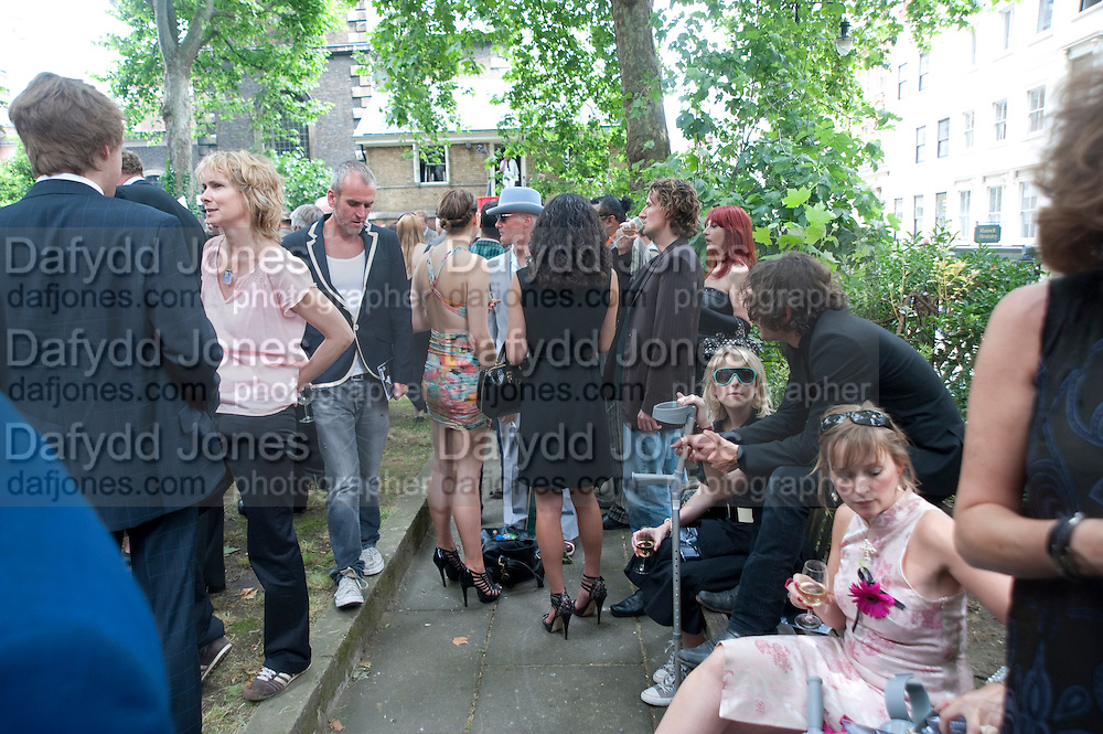 TICKY HEDLEY-DENT; NICK HACKWORTH, Sebastian Horsley funeral. St. James's church. St. James. London afterwards in the church garden. July 1 2010. -DO NOT ARCHIVE-© Copyright Photograph by Dafydd Jones. 248 Clapham Rd. London SW9 0PZ. Tel 0207 820 0771. www.dafjones.com.