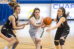 Wyoming East forward Brianne Pertee (25) passes the ball outside to a teammate against Bluefield during a first round game at the Charleston Civic Center.
