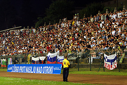 """Spectators at the last game of Slovenian """"golden team"""" at Bezigrad stadion for football made by Joze Plecnik in year 1935, before rebuilded in 2008. The match was held on June 18, 2005. In front Unicef logo """"With a ball against violence at children"""". (Photo by Vid Ponikvar / Sportal Images)."""