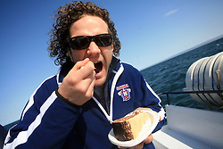 Gaber Glavic eating a cake at whale watching boat, when some guys of Slovenian Team were celebrating an anniversary of playing for the team, during IIHF WC 2008 in Halifax,  on May 07, 2008, sea at Halifax, Nova Scotia, Canada. (Photo by Vid Ponikvar / Sportal Images)