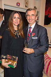 DIMITRI HORNE and MELINA HORNE at a reception to celebrate the publication of Quicksilver by HRH Princess Michael of Kent held at the home of Richard & Basia Briggs, 35 Sloane Gardens, London on 9th November 2015.