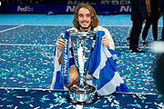 Stefanos Tsitsipas of Greece celebrates with his trophy wearing the flag of Greece during the Nitto ATP finals at the O2 Arena, London, United Kingdom on 17 November 2019.
