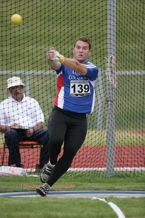(Charlottetown, Prince Edward Island -- 20090714) Angus J. Taylor of BC Athletics competes in the  hammer throw at the 2009 Canadian Junior Track & Field Championships at UPEI Alumni Canada Games Place on the campus of the University of Prince Edward Island, July 17-19, 2009.  Sean Burges / Mundo Sport Images ..Mundo Sport Images has been contracted by Athletics Canada to provide images to the media.