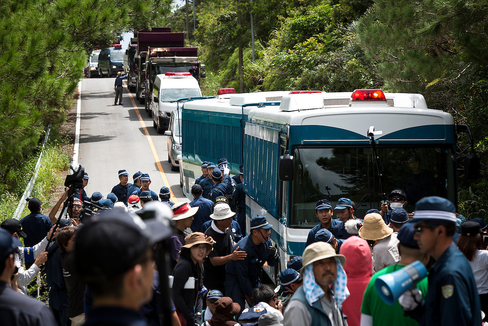 OKINAWA, JAPAN - SEPTEMBER 14 : Anti U.S base protesters is seen being removed by police after blocking the trucks to protest against the construction of helipads in front of the gate of U.S. military's Northern Training Area in the village of Higashi, Takae, Okinawa Prefecture, Japan on September 14, 2016. The Japanese government is allowing the use of its own Japan Air Self-Defense Force military helicopters Boeing CH-47 to get construction heavy equipments past the protesters on Tuesday, September 13 in order to speed up completion of six new helipads to be use by U.S Military.  (Photo by Richard Atrero de Guzman/NURPhoto)