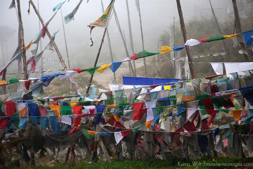Asia, Bhutan, Trongsa. Prayer flags mark Yutong La Pass, between Trongsa and Bumthang.