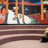 Jaxson Parker plays by himself inside the library during the Tobe Turpen Elementary Fall Festival Thursday in Mentmore.