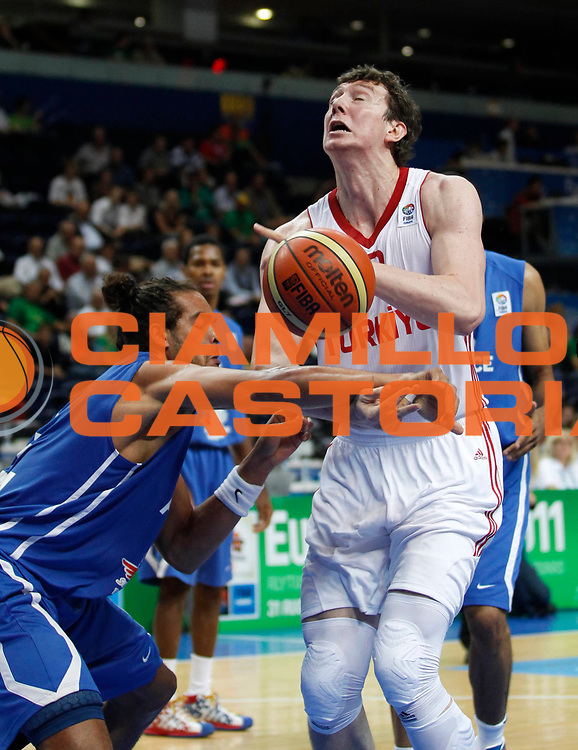DESCRIZIONE : Vilnius Lithuania Lituania Eurobasket Men 2011 Second Round Turchia Francia Turkey France<br /> GIOCATORE : Omer Asik<br /> SQUADRA : Turchia Turkey<br /> EVENTO : Eurobasket Men 2011<br /> GARA : Turchia Francia Turkey France<br /> DATA : 07/09/2011 <br /> CATEGORIA : palleggio<br /> SPORT : Pallacanestro <br /> AUTORE : Agenzia Ciamillo-Castoria/M.Metlas<br /> Galleria : Eurobasket Men 2011 <br /> Fotonotizia : Vilnius Lithuania Lituania Eurobasket Men 2011 Second Round Turchia Francia Turkey France<br /> Predefinita :