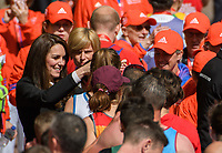 TRH The Duke and Duchess of Cambridge and Prince Harry hand out medals to runners after the finish line. The Virgin Money London Marathon, 23rd April 2017.<br /> <br /> Photo: Thomas Lovelock for Virgin Money London Marathon<br /> <br /> For further information: media@londonmarathonevents.co.uk