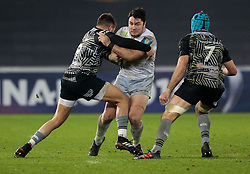 Saracens' Brad Barritt is tackled by Ospreys' Rhys Webb<br /> <br /> Photographer Simon King/Replay Images<br /> <br /> European Rugby Champions Cup Round 5 - Ospreys v Saracens - Saturday 13th January 2018 - Liberty Stadium - Swansea<br /> <br /> World Copyright © Replay Images . All rights reserved. info@replayimages.co.uk - http://replayimages.co.uk