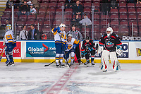 KELOWNA, CANADA - DECEMBER 1: Riley McKay #39 and Seth Bafaro #8 of the Saskatoon Blades take part in a pre-game conversation with Michael Farren #16 of the Kelowna Rockets during warm up on December 1, 2018 at Prospera Place in Kelowna, British Columbia, Canada.  (Photo by Marissa Baecker/Shoot the Breeze)