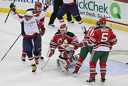 Mar 18; Newark, NJ, USA; Washington Capitals left wing Alex Ovechkin (8) celebrates a goal by Washington Capitals defenseman Jeff Schultz (55) during the first period at the Prudential Center.