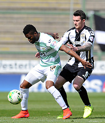 Yeovil Town's Joel Grant is tackled by James Spencer of Notts County- Photo mandatory by-line: Harry Trump/JMP - Mobile: 07966 386802 - 11/04/15 - SPORT - FOOTBALL - Sky Bet League One - Yeovil Town v Notts County - Huish Park, Yeovil, England.