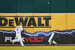 OAKLAND, CA - SEPTEMBER 09:  Max Muncy #12 of the Oakland Athletics and Jake Smolinski #5 are unable to field a ball hit for an RBI double by Nelson Cruz (not pictured) of the Seattle Mariners during the first inning at the Oakland Coliseum on September 9, 2016 in Oakland, California. (Photo by Jason O. Watson/Getty Images) *** Local Caption *** Max Muncy; Jake Smolinski