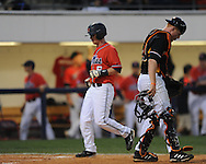 Mississippi's Kevin Mort scores vs. Tennessee's Blake Forsythe in a  college baseball at Oxford-University Stadium on Friday, April 2, 2010 in Oxford, Miss. Ole Miss won 7-3.