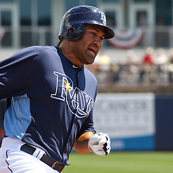 March 15, 2011; Port Charlotte, FL, USA; Tampa Bay Rays left fielder Johnny Damon (22) runs home on a hit by third baseman Evan Longoria (not pictured) during a spring training exhibition game against the Florida Marlins at Charlotte Sports Park.   Mandatory Credit: Derick E. Hingle