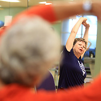Amy Phipps, yoga instructor, teachers her class at the Wellness Center in Tupelo on Wednesday morning.