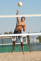 Young Man Spiking the Ball