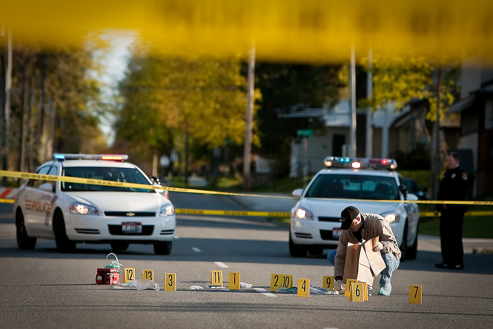 JEROME A. POLLOS/Press..A Coeur d'Alene Police detective process the site of a murder at the 300-block of Third Street early Saturday morning. Juan C. Aldana Villanueva, 22, was arrested at 11:20 a.m. Saturday for the murder of the 21-year-old victim which occurred about nine hours earlier.