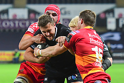 Ospreys' Ashley Beck is tackled by Dragons' Hallam Amos - Mandatory by-line: Craig Thomas/JMP - 27/10/2017 - RUGBY - Liberty Stadium - Swansea, Wales - Ospreys v Dragons - Guinness Pro 14