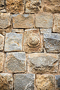 KADIRI, INDIA - 23rd October 2019 - Close-up wall texture of stone carving at Bangalore fort, Bengaluru, Karnataka, India, South India