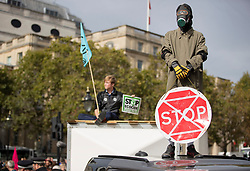 © Licensed to London News Pictures. 07/10/2019. London, UK. Extinction Rebellion activists stand on vehicles in Trafalgar Square, central London. Activists are converging on Westminster blockading roads in the area for at least two weeks calling on government departments to 'Tell the Truth' about what they are doing to tackle the Emergency. Photo credit: Peter Macdiarmid/LNP