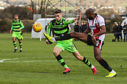Forest Green Rovers Will Randall(19) challenges for the ball during the The Central League match between Cheltenham Town Reserves and Forest Green Rovers Reserves at The Energy Check Training Ground, Cheltenham, United Kingdom on 28 November 2017. Photo by Shane Healey.