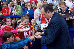 BIRKENHEAD, ENGLAND - Saturday, July 12, 2008: Liverpool's manager Rafael Benitez signs autographs for fans during his side's first pre-season match of the 2008/2009 season against Tranmere Rovers at Prenton Park. (Photo by David Rawcliffe/Propaganda)