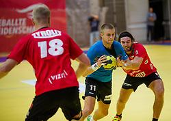 17.09.2015, Sporthalle, Leoben, AUT, HLA, Grunddurchgang, Union JURI Leoben vs Sparkasse Schwaz Handball Tirol, im Bild v.l.: Anton Prakapenia (Schwaz), Benas Petreikis (Leoben), Andreas Lassner (Schwaz) // during the HLA between Union JURI Leoben vs Sparkasse Schwaz Handball Tirol at the Sport Hall, Leoben, Austria on 2015/09/17, EXPA Pictures © 2015, PhotoCredit: EXPA/ Dominik Angerer