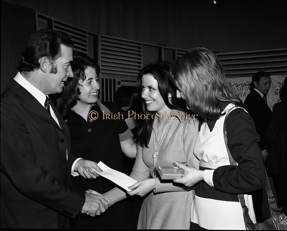 Classified Telephone Girl of the Year..1972..18.12.1972..12.18.1972..18th December 1972..The Area Final Ireland of the Classified telephone Girl of the year 72/73 was held in the Telecommunications Centre, Booterstown Ave. The winner will go forward to the next round at The Grand Hotel,Manchester in February next..The competition was organised by The Irish Times..The contestants were:.Ms Kathy Bannon, Farming Life, Belfast..Ms Carol Budd, Evening Herald,Dublin..Ms Dorothy Gough,Irish Field,Dublin..Ms Linda Hanna,News Letter,Belfast..Ms Susan Harrigan,Sunday News,Belfast..Ms Sophie Kelleher,The Cork Examiner..Ms Marie O'Callaghan,Evening Echo,Cork..Ms Bernadette O'Neill,Irish Independent,Dublin..Ms Rose O'Riordan,Irish Times,Dublin..Ms Pat O'Connell,Belfast Telegraph...Image of the compere,Mr Bunny Carr,congratulating the competition winner Ms Kathy Bannon,Windsor Ave,Malone Road,Belfast also included are Ms Sophie Kelleher,Cork and Ms Marie O'Callaghan,Cork.
