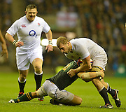 Twickenham, GREAT BRITAIN,    Chris ROBSHAW,  tackled low by, Pat LAMBIE,  during the QBE. Autumn International;  England vs South Africa, Rugby match.  Autumn, International Test Series.  RFU. Twickenham Stadium, Surrey.  Saturday,  24/11/2012 ..[Mandatory Credit; Peter Spurrier/Intersport-images]