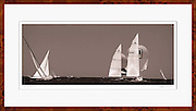 A sepia toned photograph of 12 Meter Class racing sailboats.