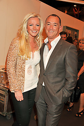 MICHELLE MONE and KARL FRENCH at the Graduate Fashion Week Gala drinks reception held at Earls Court 2, London on 13th June 2012.