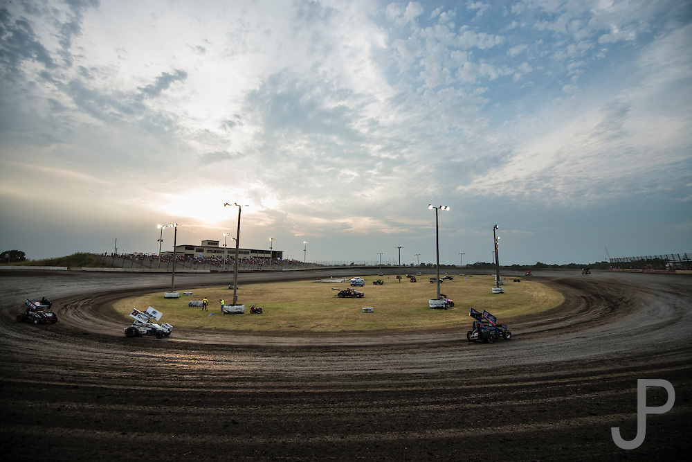 The sun sets over Salina High Banks Speedway as the Sprint cars run their qualifying laps.