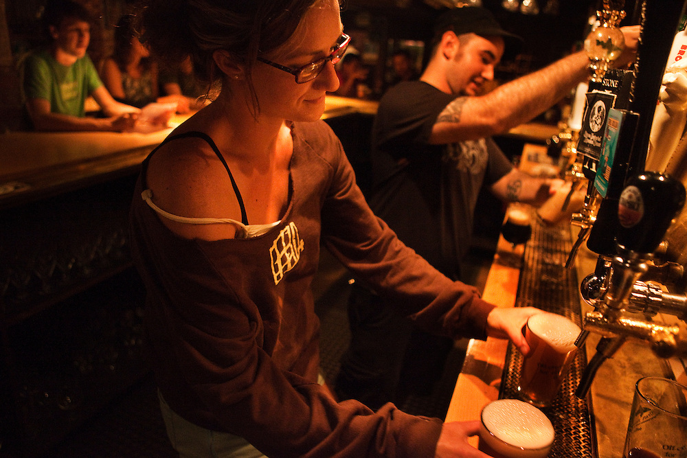 Bartenders, Erika Colby and Jeff Hodenberg pour beers from Belgium to California at Novare Res Bier Cafe in Portland, Maine.