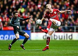 Hordur Magnusson of Bristol City is challenged by Bernardo Silva of Manchester City - Rogan/JMP - 23/01/2018 - Ashton Gate Stadium - Bristol, England - Bristol City v Manchester City - Carabao Cup Semi Final Second Leg.