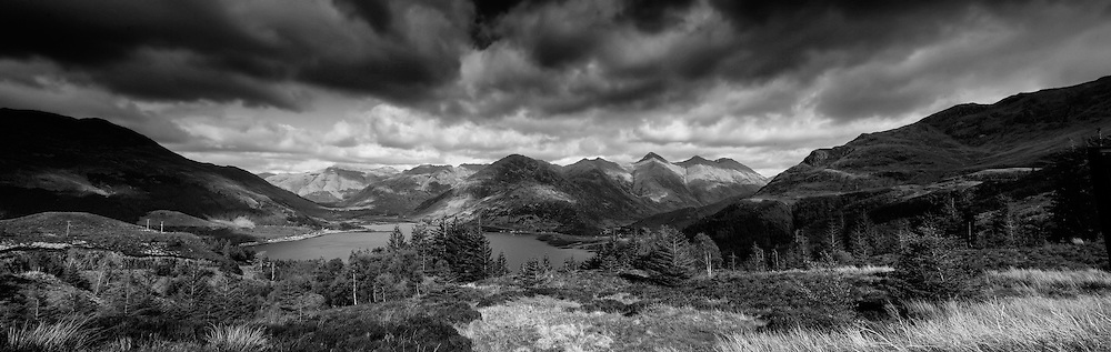 The Five Sisters of Kintail form one of Scotland's finest and most famous views when seen from Ratagan on the shores of Loch Duich, and have been under the care of the National Trust for Scotland since 1944.<br /> <br /> This photograph is a monochromatic version of the view of The 5 Sisters of Kintail from Måm Rataggan. The photograph can be purchased as print, mounted print in frames, canvas or aluminum or as a digital file.