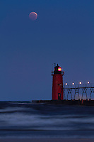 The Blood Moon of October 2014 as it makes its decent towards the lighthouse in South Haven, MI