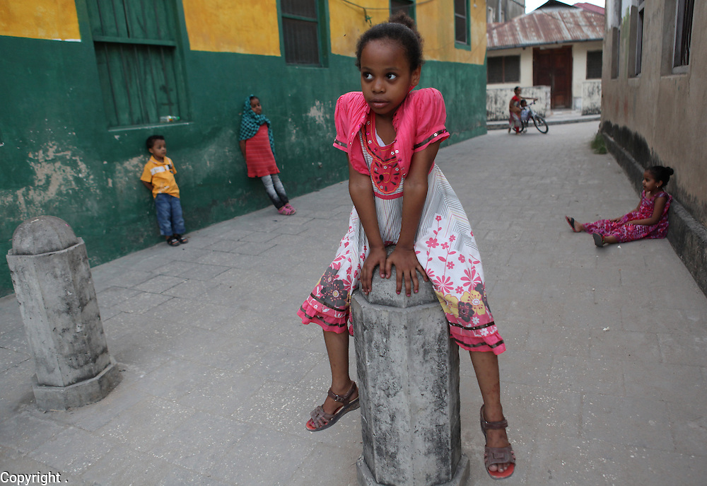 A young girl is photographed in Stone Town in Zanzibar, Tanzania. Julia