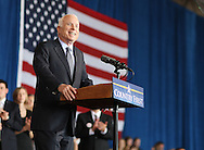 US Republican presidential nominee Senator John McCain (R-AZ)  smiles as the speaks to the crowd at a campaign rally in Cedar Rapids, Iowa, September 18, 2008.