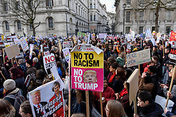 © Licensed to London News Pictures. 04/02/2017. London, UK. Thousands of people, standing against racism and Islamophobia, are seen in Whitehall outside Downing Street to oppose the travel ban on Muslims, from seven countries, imposed by Donald Trump, U.S. President. Photo credit : Stephen Chung/LNP