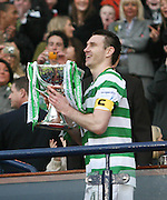Stephen McManus lifts the League Cup final after Celtic had wooon the final between Rangers and Celtic at Hampden Park -<br /> David Young