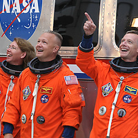 The space shuttle Atlantis astronauts left to right, Sandy Magnus, pilot Doug Hurley and commander Chris Ferguson wave after leaving the operations and check-out building on their way to the pad at the Kennedy Space Center Friday, July 8, 2011, in Cape Canaveral, Fla. Shuttle Atlantis is scheduled to launch on Friday, July 8 and is the 135th and final space shuttle launch for NASA..  (AP Photo/Alex Menendez)