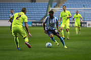 Coventry City forward Jacob Murphy on loan from Norwich City takes on Southend United defender John White during the Sky Bet League 1 match between Coventry City and Southend United at the Ricoh Arena, Coventry, England on 31 August 2015. Photo by Simon Davies.
