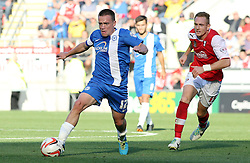 Peterborough United's Paul Taylor in action with Rotherham United's Robert Milsom - Photo mandatory by-line: Joe Dent/JMP - Tel: Mobile: 07966 386802 28/09/2013 - SPORT - FOOTBALL - New York Stadium - Rotherham - Rotherham United V Peterborough United - Sky Bet One