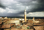 Italy, Tuscany, Siena, Piazza del Campo, Palazzo Publico and Torre del Manga on a stormy day