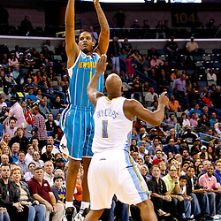 October 29, 2010; New Orleans, LA, USA; New Orleans Hornets small forward Trevor Ariza (1) shoots over Denver Nuggets point guard Chauncey Billups (1) during the fourth quarter at the New Orleans Arena. The Hornets defeated the Nuggets 101-95.  Mandatory Credit: Derick E. Hingle
