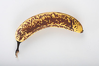 Old banana on white background