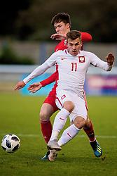 BANGOR, WALES - Monday, October 15, 2018: Poland's Daniel Liszka is tackled by Wales' Morgan Boyes (top) during the UEFA Under-19 International Friendly match between Wales and Poland at the VSM Bangor Stadium. (Pic by Paul Greenwood/Propaganda)