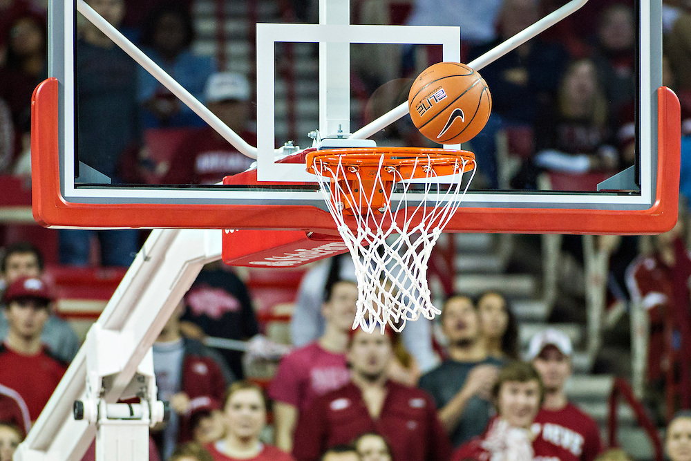 FAYETTEVILLE, AR - NOVEMBER 18:  Ball bounces on the rim during a game between the Arkansas Razorbacks and the SMU Mustangs at Bud Walton Arena on November 18, 2013 in Fayetteville, Arkansas.  The Razorbacks defeated the Mustangs 89-78.  (Photo by Wesley Hitt/Getty Images) *** Local Caption ***