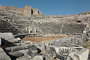 The Hellenistic theatre, 4th century BC, later enlarged by the Romans in the 2nd century AD, Miletus, Aydin, Turkey. The new building under Emperor Trajan seated 25,000 and a third floor was added to the stage building, which was decorated with columns and hunting scenes with Eros. In the centre of the first two rows, four columns designated a special box for the emperors, seen here. The theatre was situated on the edge of the harbour. Miletus was an Ancient Greek city on the Western coast of Anatolia. Although settlement began here millennia ago, its heyday was in the Hellenistic and Roman periods. The city was finally abandoned in the Ottoman era when the harbours silted up. Picture by Manuel Cohen